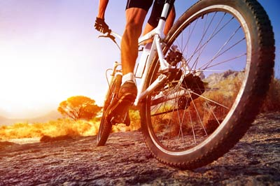 Cyclist on dirt road